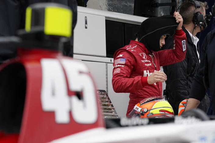 Santino Ferrucci waits in his pits during testing at the Indianapolis Motor Speedway, Thursday, April 8, 2021, in Indianapolis. (AP Photo/Darron Cummings)