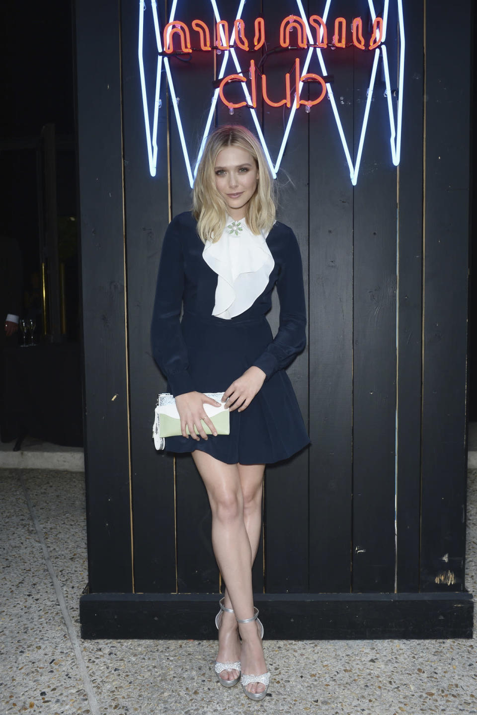 <p>While she might have had a Marilyn moment while attending the Miu Miu Club's launch party in Paris, she still shined in this Miu Miu dress.<br><br></p>