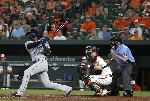 Tampa Bay Rays' Adeiny Hechavarria watches his RBI single in front of Baltimore Orioles catcher Caleb Joseph and umpire Phil Cuzzi during the seventh inning of a baseball game, Thursday, July 26, 2018, in Baltimore. (AP Photo/Patrick Semansky)