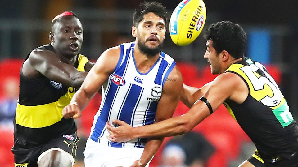 Aaron Hall, pictured here in action for North Melbourne in the AFL.