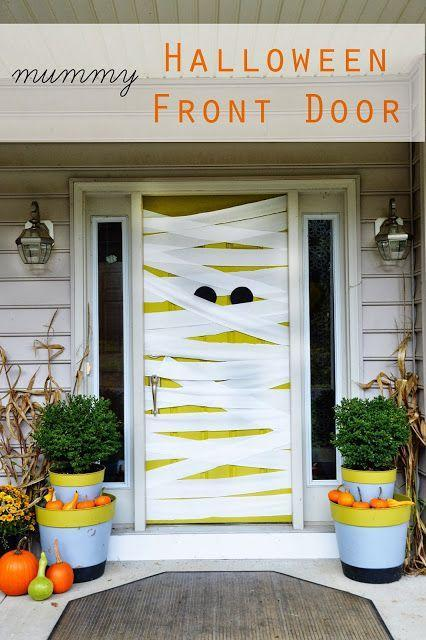"""<p>You'll be mummy of the year when you transform your front door into this watchful monster.<br></p><p><strong>Get the tutorial at <a href=""""http://eastcoastcreativeblog.com/2013/10/fall-halloween-porch-decor.html"""" rel=""""nofollow noopener"""" target=""""_blank"""" data-ylk=""""slk:East Coast Creative"""" class=""""link rapid-noclick-resp"""">East Coast Creative</a>.</strong> </p>"""