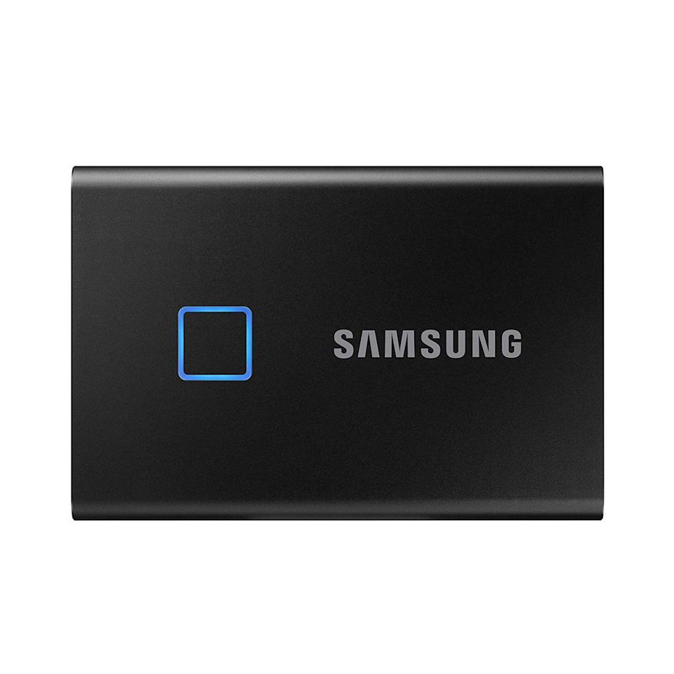 """<p><strong>Samsung</strong></p><p>amazon.com</p><p><strong>$119.99</strong></p><p><a href=""""https://www.amazon.com/dp/B082YHBYNJ?tag=syn-yahoo-20&ascsubtag=%5Bartid%7C2089.g.864%5Bsrc%7Cyahoo-us"""" rel=""""nofollow noopener"""" target=""""_blank"""" data-ylk=""""slk:Shop Now"""" class=""""link rapid-noclick-resp"""">Shop Now</a></p><p>The Samsung T7 Touch portable SSD sets itself apart from the competition with its built-in fingerprint scanner. The feature allows you to access your encrypted files with one touch. It's compatible with Mac, PC, and mobile devices. It's easy to set up via a desktop software suite or a mobile app. </p><p>The palm-sized gadget can reach blisteringly fast data read and write speeds of up to 1,050 and 1,000 MB/s respectively. It's also equipped with a convenient, futureproof USB-C connector. </p><p>You can order to the Samsung T7 Touch with up to 2 TB of storage and it's available to buy in silver or black.</p>"""