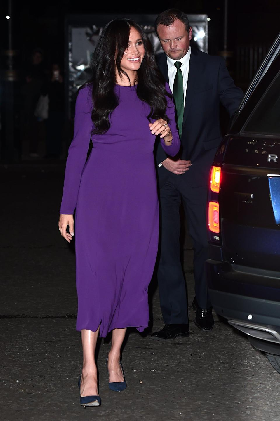 """<p>Meghan brought out <a href=""""https://www.popsugar.com/fashion/meghan-markle-purple-dress-at-one-young-world-summit-46794434"""" class=""""link rapid-noclick-resp"""" rel=""""nofollow noopener"""" target=""""_blank"""" data-ylk=""""slk:this gorgeous purple Aritzia midi dress once again"""">this gorgeous purple Aritzia midi dress once again</a> to attend the One Young World Summit Opening Ceremony at Royal Albert Hall in October 2019.</p>"""