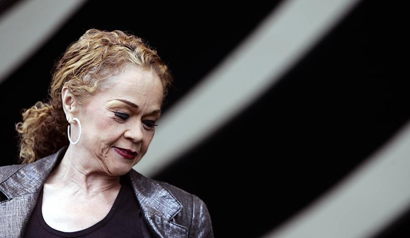 """FILE - In this April 29, 2006 photo, Etta James performs during the 2006 New Orleans Jazz and Heritage Festival in New Orleans.  James, the feisty rhythm and blues singer whose raw, passionate vocals anchored many hits and made the yearning ballad """"At Last"""" an enduring anthem for weddings, commercials and even President Barack Obama, died Friday, Jan. 20, 2012. She was 73. James had been suffering from dementia and kidney problems, and was battling leukemia. In December 2011, her physician announced that her leukemia was terminal.   (AP Photo/Jeff Christensen)"""