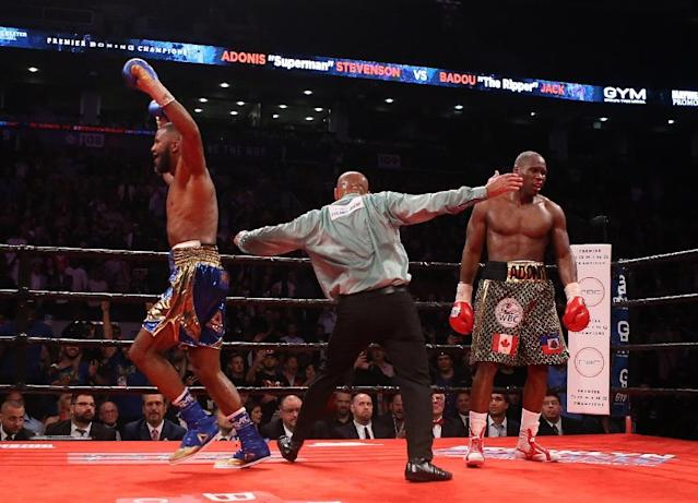 Badou Jack (L) celebrates at the end his WBC Light Heavyweight title fight against Adonis Stevenson (R) which ended in a draw (AFP Photo/Vaughn Ridley)
