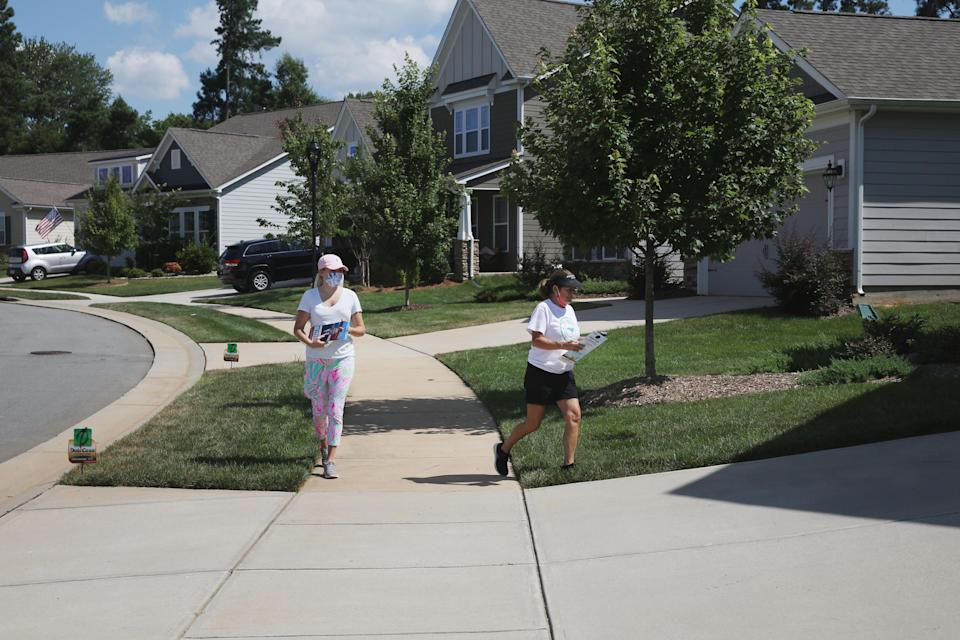 Republican canvassers visit homes in a neighborhood in Mooresville, N.C., July 22, 2020. (Travis Dove/The New York Times)