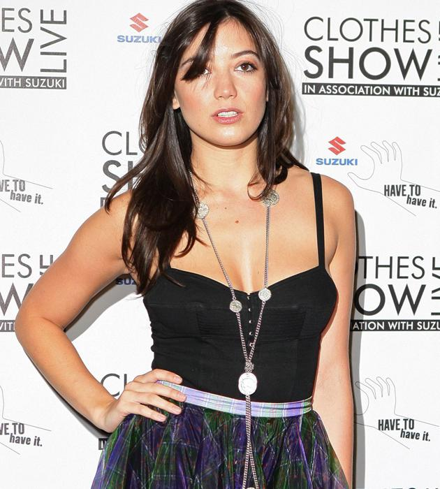 Daisy Lowe wowed in a sheer tartan skirt and black vest at the Clothes Show 2012 ©Rex