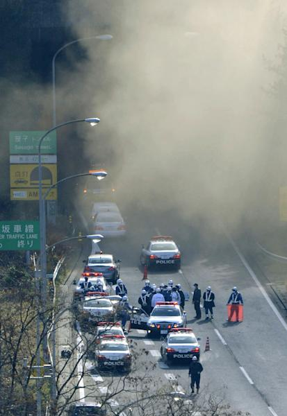 Smoke billows out of the Sasago Tunnel on the Chuo Expressway in Koshu, Yamanashi Prefecture, central Japan, Sunday morning, Dec. 2, 2012. A part of the tunnel collapsed Sunday morning, possibly involving several vehicles and injuring several people, local media said. (AP Photo/Kyodo News) JAPAN OUT, MANDATORY CREDIT, NO LICENSING IN CHINA, FRANCE, HONG KONG, JAPAN AND SOUTH KOREA
