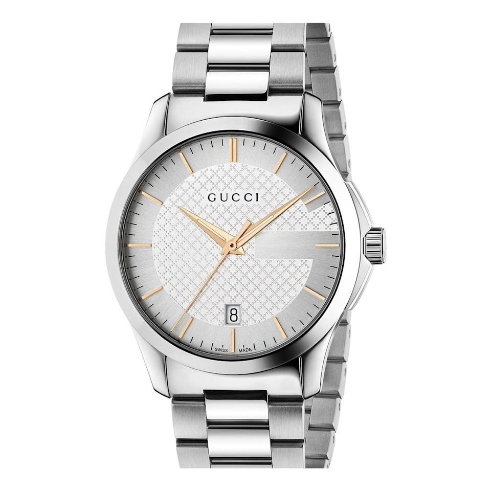 """<p>This super sleek stainless steel watch from Gucci boasts a scratch-resistant sapphire crystal face and an easy-to-use deployant clasp closure that keeps the watch securely on your wrist. What's more, it features a handy date function so you'll never forget what day it is, and it's powered by a Swiss quartz movement for that classic """"ticking"""" feature. We're obsessed with its simple chic design and the classic Gucci """"G"""" logo featured in the watch's face.</p>"""