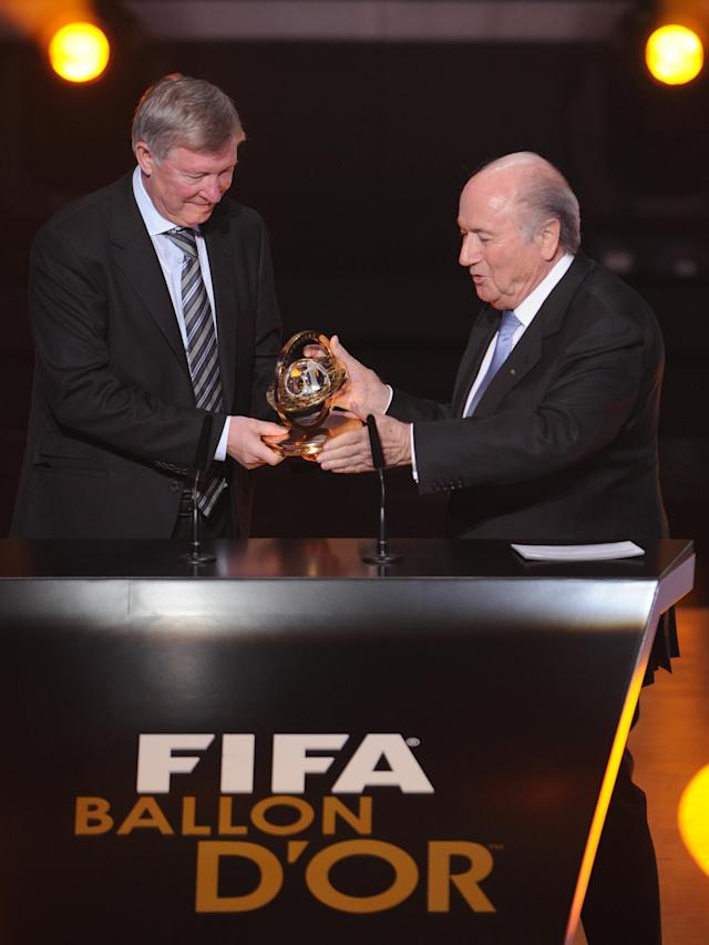 Manchester Uninted British coach Sir Alex Ferguson receives the FIFA Presidential Award from FIFA president Sepp Blatter (R) during the FIFA ballon d'or ceremony on January 9, 2012 at the Kongresshaus in Zurich. AFP PHOTO / FRANCK FIFE (Photo credit should read FRANCK FIFE/AFP/Getty Images)