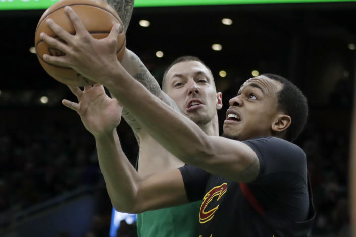 Cleveland Cavaliers forward John Henson, right, goes to the hoop against Boston Celtics forward Daniel Theis in the first half of an NBA basketball game, Friday, Dec. 27, 2019, in Boston. (AP Photo/Elise Amendola)