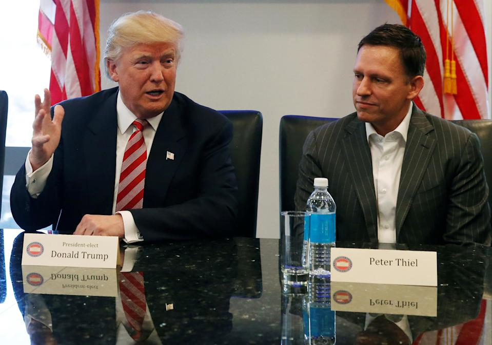 US President-elect Donald Trump sits with PayPal co-founder and Facebook board member Peter Thiel during a meeting with technology leaders at Trump Tower in New York, United States, December 14, 2016. REUTERS / Shannon Stapleton