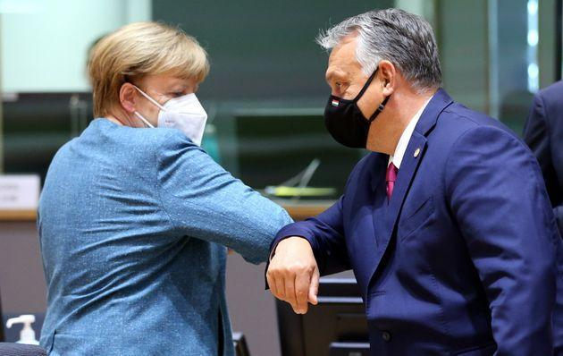 BRUSSELS, BELGIUM - OCTOBER 01: Hungary's Prime Minister Viktor Orban and German Chancellor Angela Merkel attend the European Union (EU) Leaders' Summit in Brussels, Belgium on October 01, 2020. (Photo by Dursun Aydemir/Anadolu Agency via Getty Images) (Photo: Anadolu Agency via Getty Images)