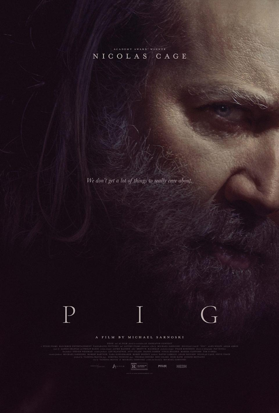 Nicolas Cage's face on the dark, shadowy poster for the movie Pig.