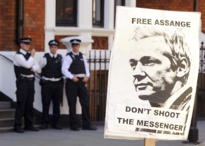 A pro-Julian Assange placard is seen outside the Embassy of Ecuador, in central London, Saturday August 18, 2012, where Wikileaks founder Julian Assange is claiming asylum in an effort to avoid extradition to Sweden.  Authorities in Sweden want to question Assange over allegations made by two women who accuse him of sexual misconduct during a visit to the country in mid-2010, but Assange asserts that the US will try to extradite him from Sweden to answer allegations relating to the WikiLeaks publication of US secrets. (AP Photo / Dominic Lipinski/PA) UNITED KINGDOM OUT - NO SALES - NO ARCHIVES
