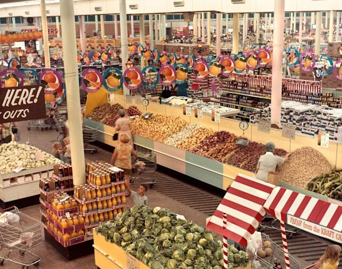 <p>An aerial view of this busy supermarket in New Orleans shows a fully stocked produce section with plenty of signage for as far as the eye can see.</p>