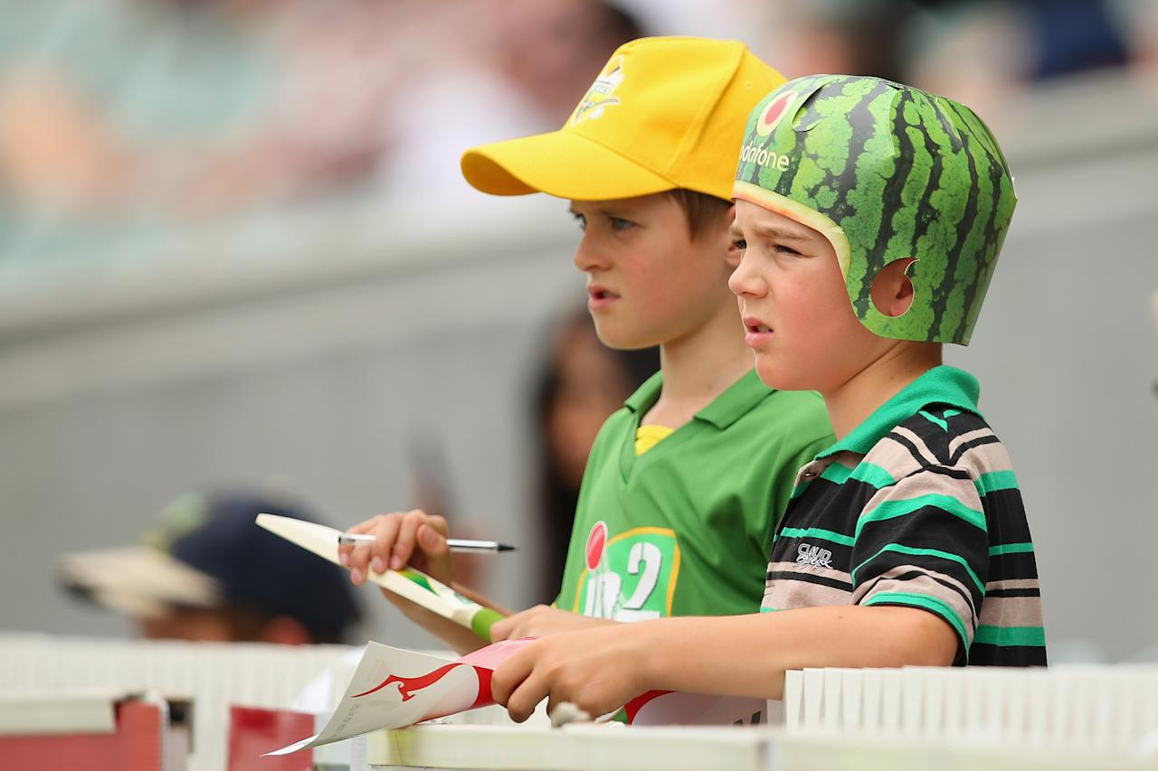 ADELAIDE, AUSTRALIA - NOVEMBER 24: Young Australian supporters watch the action during day three of the Second Test Match between Australia and South Africa at Adelaide Oval on November 24, 2012 in Adelaide, Australia.  (Photo by Cameron Spencer/Getty Images)