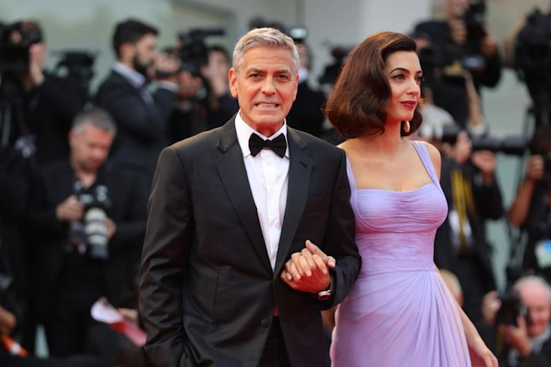 The actor and wife Amal took his and her tans to a new level. Source: Getty