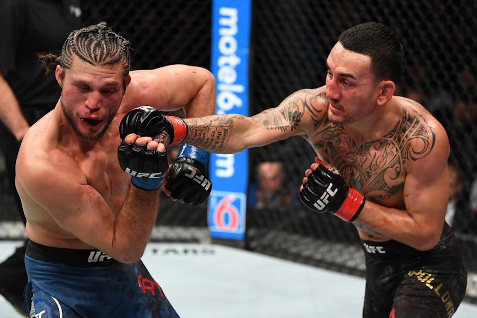 Max Holloway punches Brian Ortega in their UFC featherweight championship fight during UFC 231 at Scotiabank Arena on Dec. 8, 2018 in Toronto, Canada. (Getty Images)