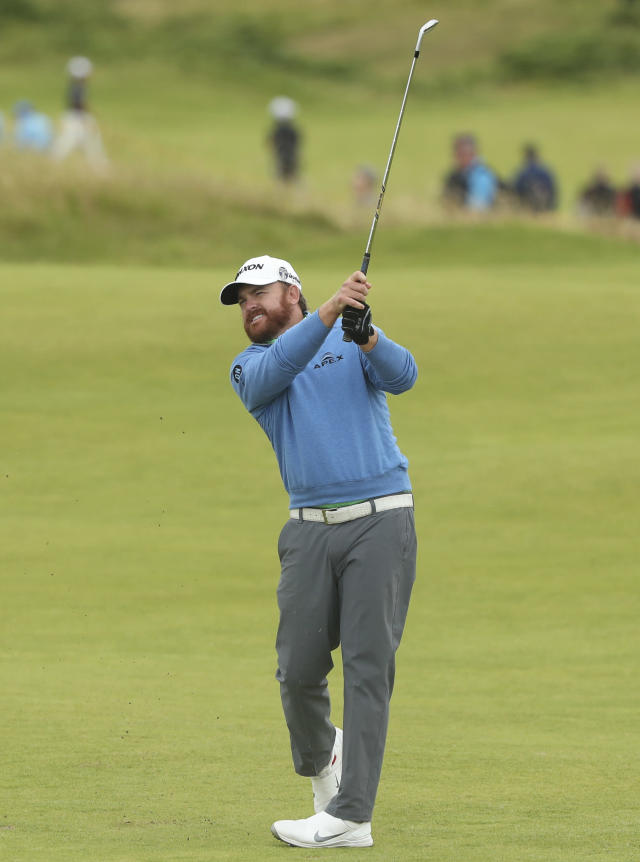 J.B. Holmes of the United States plays his second shot to the 15th green during the second round of the British Open Golf Championships at Royal Portrush in Northern Ireland, Friday, July 19, 2019.(AP Photo/Jon Super)
