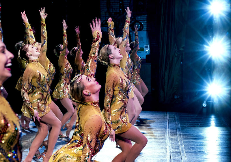 In this Monday, Nov. 25, 2019 photo, Rockette Sydney Mesher, front center, dances during a performance of the Christmas Spectacular at Radio City Music Hall in New York.  Mesher, who was born without a left hand due to the rare congenital condition symbrachydactyly, is the first person with a visible disability ever hired by New York's famed Radio City Rockettes. (AP Photo/Craig Ruttle)
