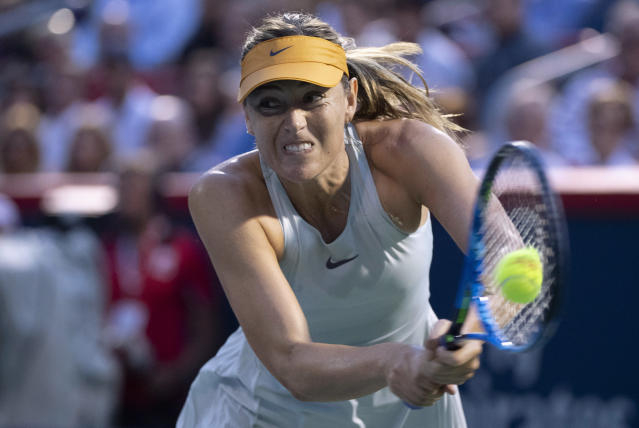 Maria Sharapova, of Russia, returns to Caroline Garcia, of France, during the Rogers Cup womens tennis tournament Thursday, Aug. 9, 2018, in Montreal. (Paul Chiasson/The Canadian Press via AP)