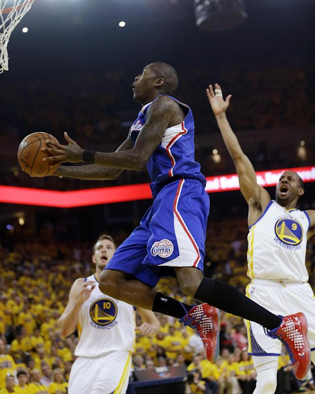 Los Angeles Clippers' Jamal Crawford, center, drives to the basket next to Golden State Warriors' Andre Iguodala (9) and David Lee (10) during the first half in Game 4 of an opening-round NBA basketball playoff series on Sunday, April 27, 2014, in Oakland, Calif. (AP Photo/Marcio Jose Sanchez)