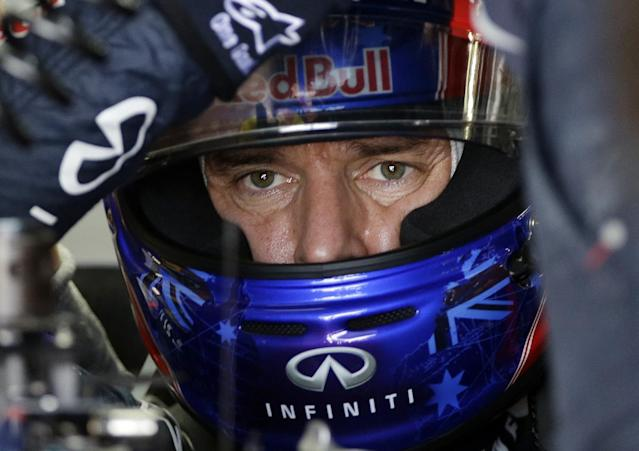 Red Bull driver Mark Webber of Australia gets out of his car after the third practice session for the Japanese Formula One Grand Prix at the Suzuka circuit in Suzuka, Japan, Saturday, Oct. 12, 2013. (AP Photo/Greg Baker)