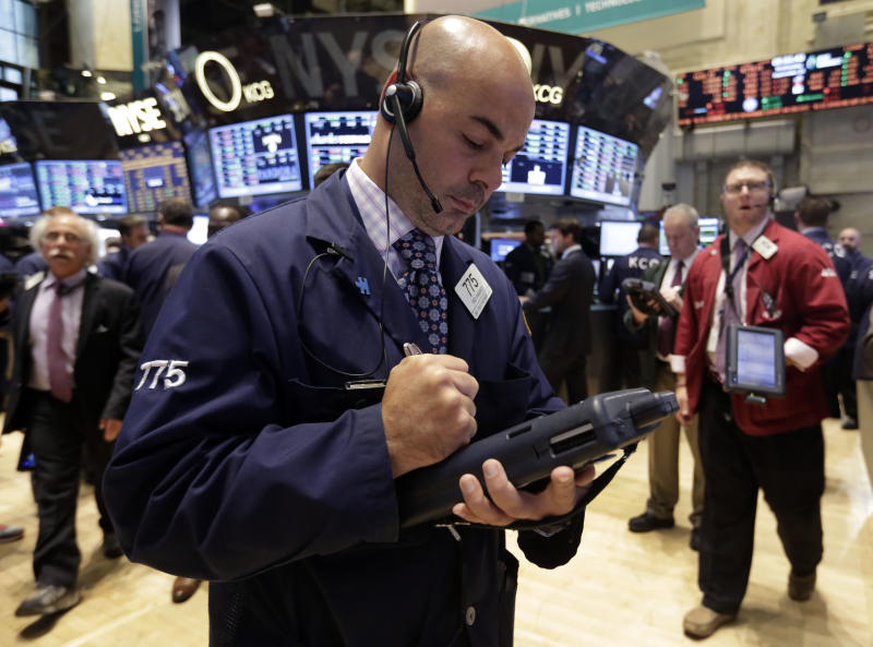 Trader Fred DeMarco works on the floor of the New York Stock Exchange Wednesday, Sept. 25, 2013. Investors continue to worry about the economy and the growing possibility of a government shutdown. (AP Photo/Richard Drew)