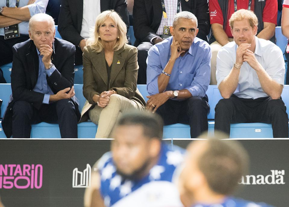 Joe Biden, Jill Biden, Barack Obama and Prince Harry sit in the stands at the Invictus Games
