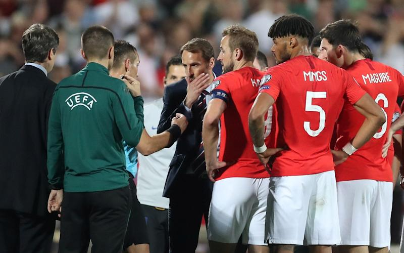 The referee twice halted the game after England players were racially abused - Action Images via Reuters