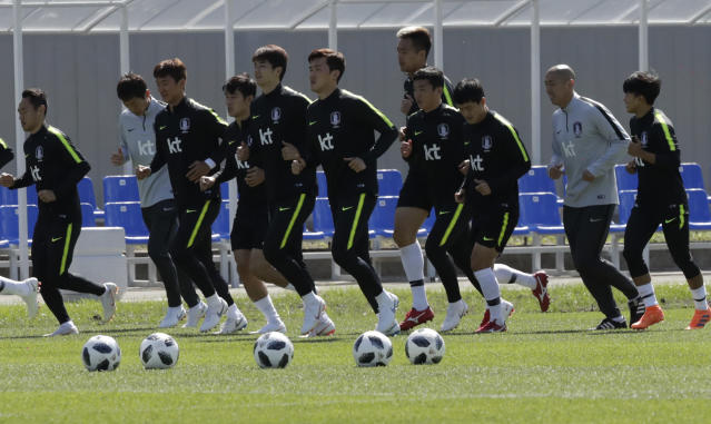 South Korean national soccer team players run during a training session of South Korea at the 2018 soccer World Cup at the Spartak Stadium in Lomonosov near St. Petersburg, Russia, Wednesday, June 20, 2018. (AP Photo/Lee Jin-man)