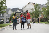 <p>Mr. Murali, right, and his family evacuate their neighbourhood after a tornado touched down, in Barrie, Ont., on Thursday, July 15, 2021. THE CANADIAN PRESS/Christopher Katsarov</p>