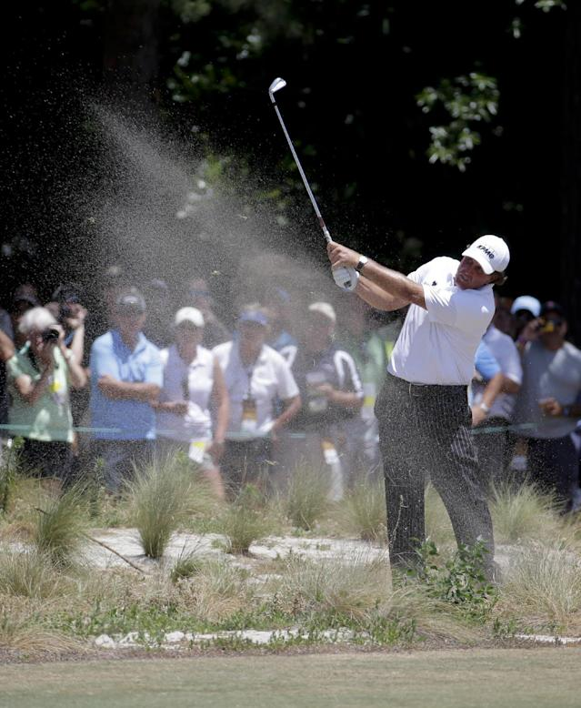 Phil Mickelson hits from the waste area on the 18th hole during a practice round for the U.S. Open golf tournament in Pinehurst, N.C., Tuesday, June 10, 2014. The tournament starts Thursday. (AP Photo/Eric Gay)