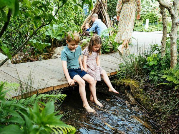 PHOTO: Prince William, Kate, Duchess of Cambridge and their children, Prince George, front, Princess Charlotte, front, and Prince Louis play in the Adam White and Andree Davies co-designed garden, in this image released on May 19, 2019. (Matt Porteous/Kensington Palace via AP)