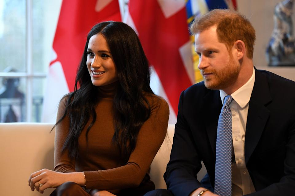 Meghan Markle, left, and Prince Harry stepped back from their roles as senior royals and announced moving to Canada part-time. (Photo: DANIEL LEAL-OLIVAS via Getty Images)