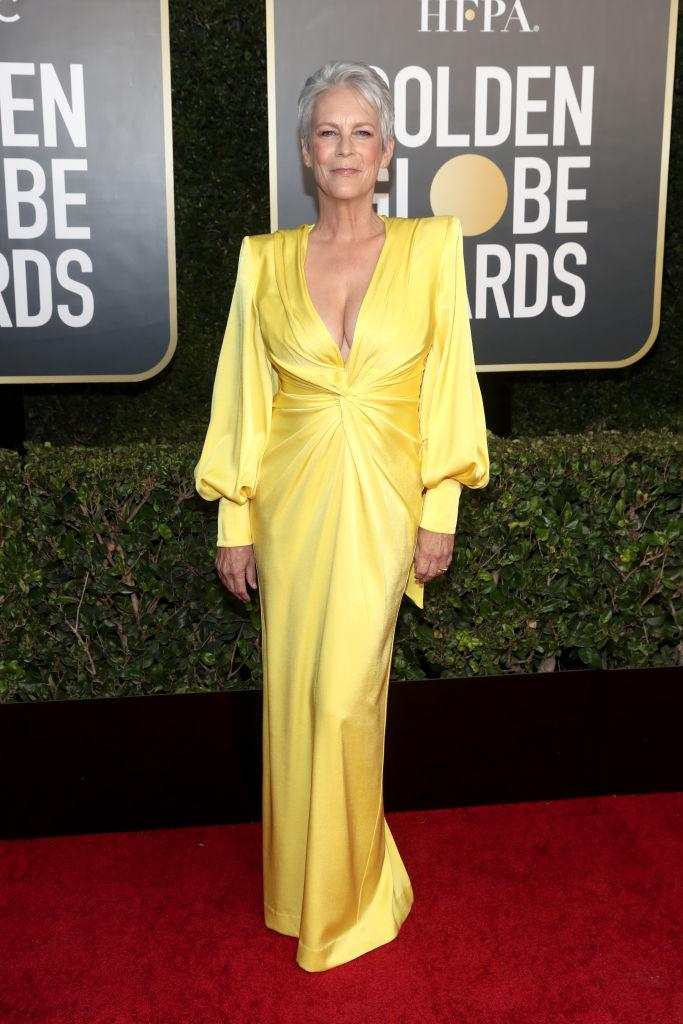 Jamie Lee Curtis opted for a plunging neckline in this sunny yellow gown. (Photo by Todd Williamson/NBC/NBCU Photo Bank via Getty Images)