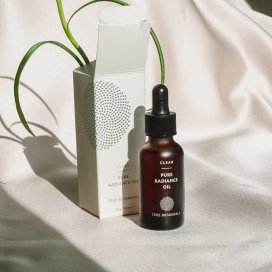 "This all-natural face oil cured Olivia Wilde's adult acne. <br> <br> <strong>True Botanicals</strong> Pure Radiance Oil, $, available at <a href=""https://go.skimresources.com/?id=30283X879131&url=https%3A%2F%2Ftruebotanicals.com%2Fproducts%2Fpure-radiance-oil-clear"" rel=""nofollow noopener"" target=""_blank"" data-ylk=""slk:True Botanicals"" class=""link rapid-noclick-resp"">True Botanicals</a>"
