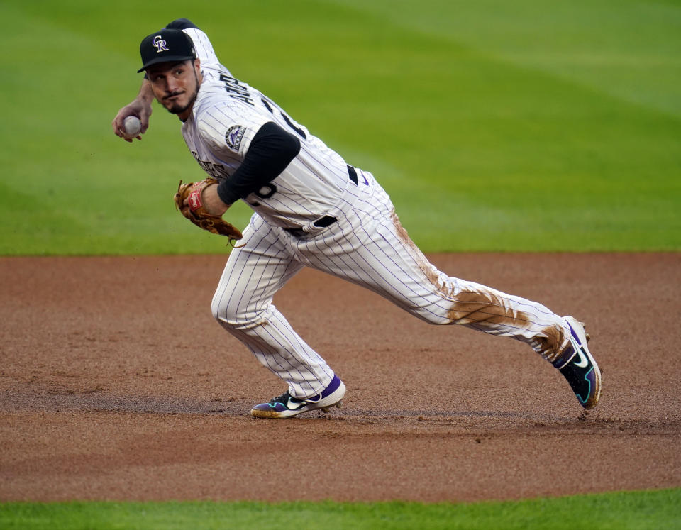 FILE - In this Sept. 11, 2020, file photo, Colorado Rockies third baseman Nolan Arenado throws to first during the first inning of a baseball game against the Los Angeles Angels in Denver. A person familiar with the swap tells The Associated Press that the St. Louis Cardinals have agreed to acquire All-Star third baseman Arenado from the Rockies in a trade needing approvals before it can be finalized. (AP Photo/David Zalubowski, File)