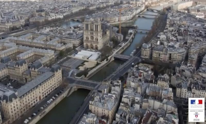 This image taken from drone video on March 19, 2020 and made available by the Prefecture de Police de Paris, shows the empty streets of Paris surrounding the Notre Dame Cathedral during lockdown to combat the spread of the new coronavirus. The footage shows landmarks and tourist hotspots in Paris completely empty, with only a few cars on the streets. For most people, the new coronavirus causes mild or moderate symptoms, such as fever and cough that clear up in two to three weeks. (Prefecture de Police de Paris via AP)
