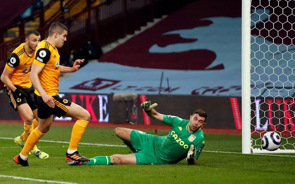 Wolverhampton Wanderers' English defender Conor Coady has a shot saved by Aston Villa's Argentinian goalkeeper Emiliano Martinez - AFP