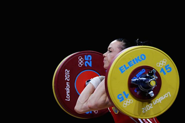 LONDON, ENGLAND - JULY 29: Iulia Paratova of Ukraine competes in the Women's 53kg Weightlifting on Day 2 of the London 2012 Olympic Games at ExCeL on July 29, 2012 in London, England. (Photo by Laurence Griffiths/Getty Images)