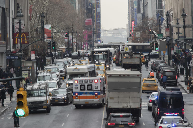 """FILE - In this Jan. 11, 2018, file photo, an ambulance is seen driving in the wrong lane to get around traffic on 42nd Street in New York. New York Gov. Andrew Cuomo told reporters Wednesday, Feb. 26, 2020, that Republican President Donald Trump is punishing blue states, including New York, over their politics as the president runs for re-election. Among the initiatives the Trump administration has not approved is """"congestion pricing,"""" a plan to reduce traffic congestion by charging Manhattan drivers. (AP Photo/Mary Altaffer, File)"""