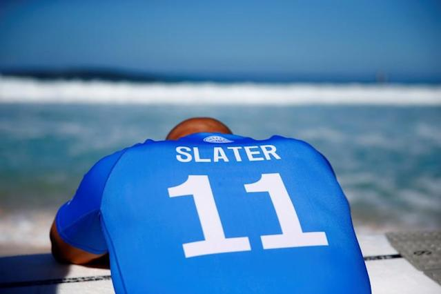 FILE PHOTO: Surfer Kelly Slater prepares for his heat at the Billabong Pipe Masters at the Banzai Pipeline in Pupukea on the island of Oahu