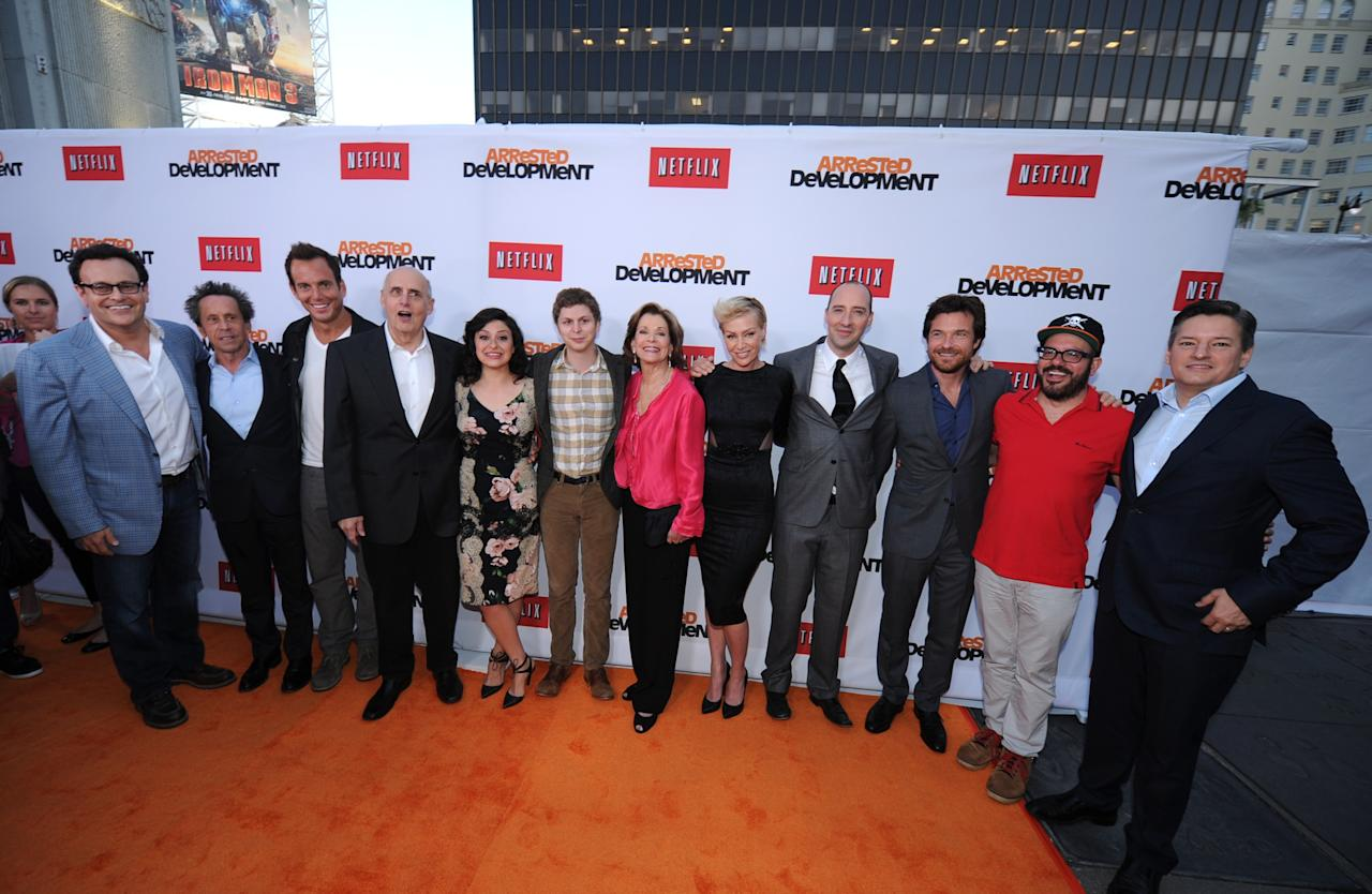 "HOLLYWOOD, CA - APRIL 29:  (L-R) Producer Mitchell Hurwitz, producer Brian Grazer, actor Will Arnett, actor Jeffrey Tambor, actress Alia Shawkat, actor Michael Cera, actress Jessica Walter, actress Portia de Rossi, actor Tony Hale, actor Jason Bateman, actor David Cross and Ted Sarandos, Chief Content Officer, Netflix arrive at the Los Angeles Premiere of Season 4 of Netflix's ""Arrested Development"" at the TCL Chinese Theatre on April 29, 2013 in Hollywood, California.  (Photo by Michael Buckner/Getty Images for Netflix)"