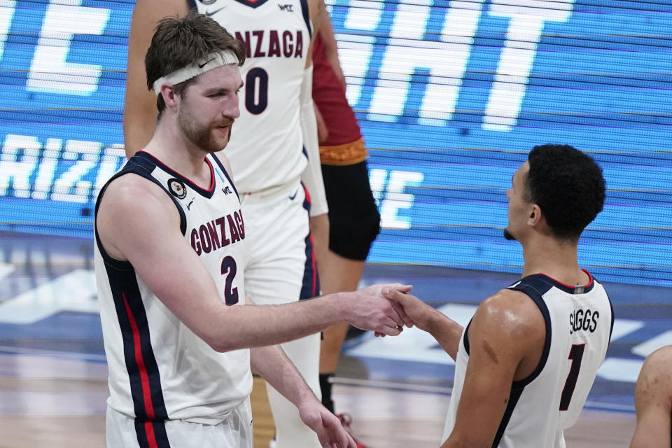 Gonzaga forward Drew Timme (2) celebrates with teammate Jalen Suggs (1) after an Elite 8 game against Southern California in the NCAA men's college basketball tournament at Lucas Oil Stadium, Tuesday, March 30, 2021, in Indianapolis. Gonzaga won 85-66. (AP Photo/Michael Conroy)