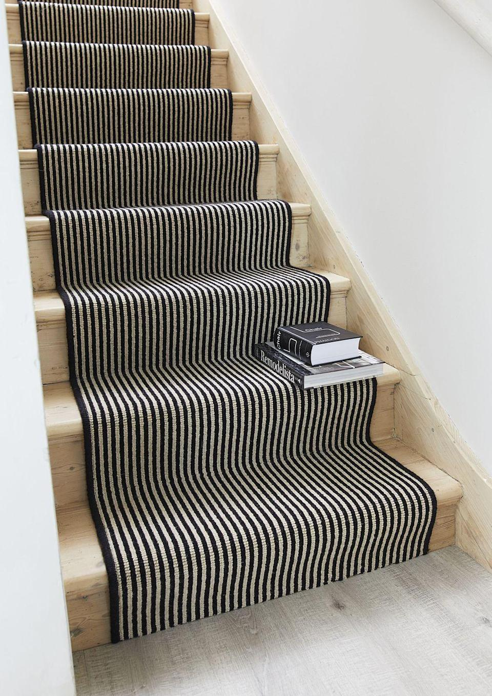 """<p>Introduce pattern in a subtle way with a stair runner. This elegant striped wool carpet from Carpetright will draw the eye upwards, elongating your stairs and giving the impression of higher ceilings. Make sure to pick a hardwearing carpet for high traffic areas such as the stairs and hallway. </p><p>Pictured: <a href=""""https://www.carpetright.co.uk/carpets/portobello/"""" rel=""""nofollow noopener"""" target=""""_blank"""" data-ylk=""""slk:Portobello Wool Carpet at Carpetright"""" class=""""link rapid-noclick-resp"""">Portobello Wool Carpet at Carpetright </a></p>"""