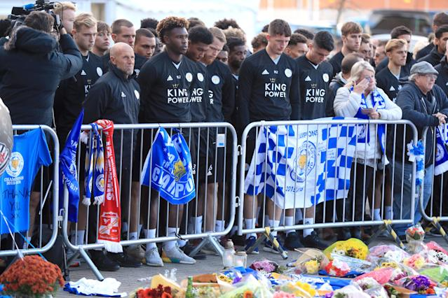 <p>Leicester City Youth Team Coach Steve Beaglehole (left) and members of the Leicester City Youth Team pay tribute at Leicester City Football Club. Mike Egerton/PA Wire/PA Images </p>