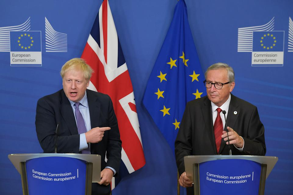 BRUSSELS, BELGIUM - OCTOBER 17: British Prime Minister Boris Johnson (L) and European Commission President Jean-Claude Juncker give statements to the media prior to a summit of European Union leaders on October 17, 2019 in Brussels, Belgium. Officials announced earlier in the day that EU and UK negotiators have reached an agreement on the United Kingdom's departure from the EU. (Photo by Sean Gallup/Getty Images)