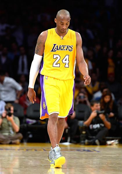 Kobe Bryant walks off, will not look into the sunset. (Harry How/Getty Images)